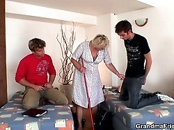 The cleaning lady undresses and the two young men get to fuck her sexy body