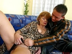 Insatiable milf pets horny erected cock with her tongue.