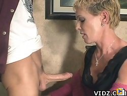 Naughty Bitch Julie Mandrews enjoys licking & sucking a young & horny stud's dick!