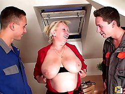 Mature blonde entertains the two guys with her hot body and they love fucking her