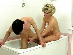 Kinky milf washes and milks a tasty boy