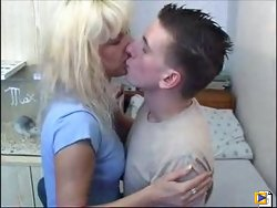 Sexy bleached blonde MILF seduces a lad to get a facial