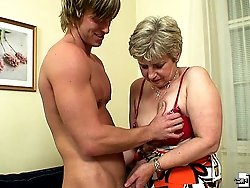 Sultry grandma sucks a hard dick and fucks him too and then he cums on her hot face