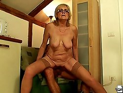 The old babe gets it from the young man and she loves the cock riding action