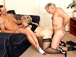 Granny is enjoying a young man's cock and an old man's cock inside her tight body