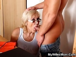 The mature blonde wears glasses and gets a big boner in her fantastic old pussy hole